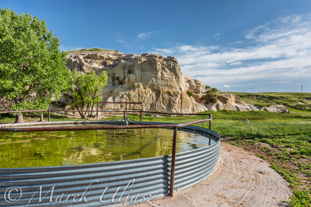 cattle water tank and rock cliff,  Pawnee Grassland