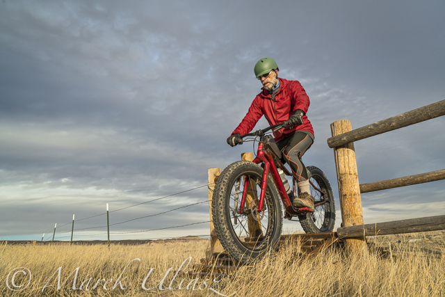 fat bike riding over cattle guard